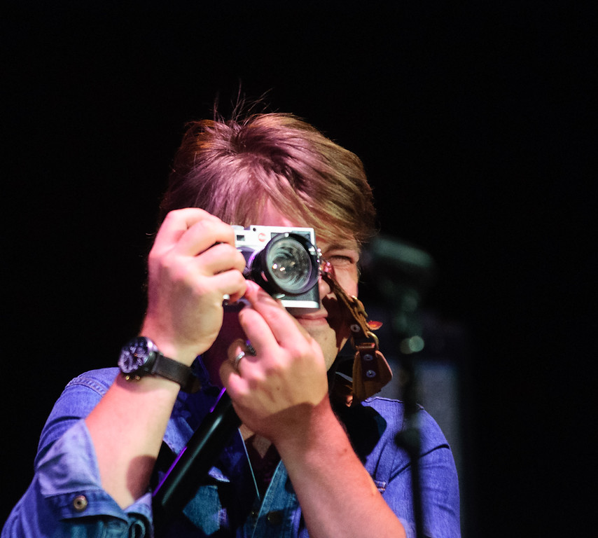 Description of . Taylor Hanson snaps a photo on the encore with Blues Traveler, July 4, 2015. Photo by Candace Horgan, heyreverb.com.